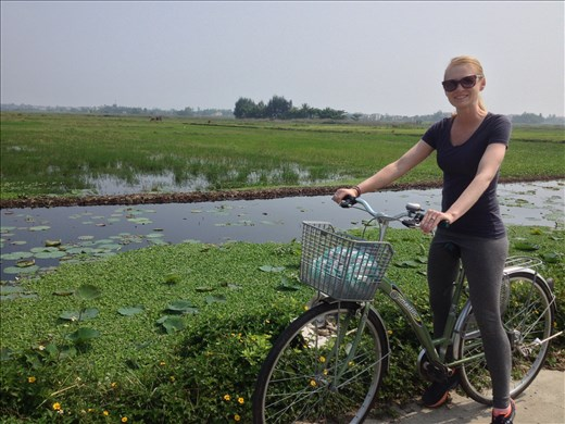Back on our bikes through rice patty fields.