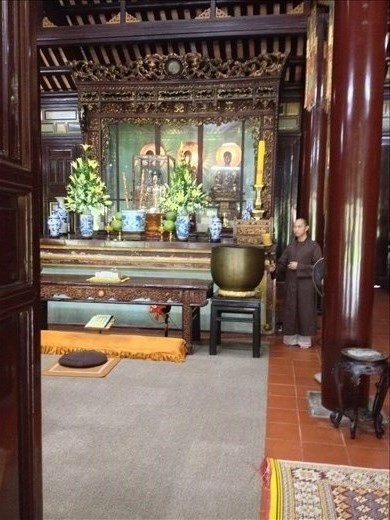 A monk sounding the gong.