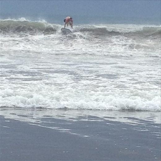 Blake catching a wave