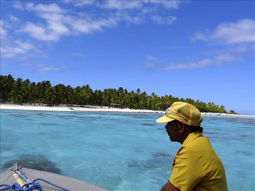On our water taxi, the mayors brother navigating the reef