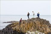 A group of teenage girls climb atop some of the 40,000 polygonal basalt columns that form the Giant's Causeway. Although the Causeway is an after effect of intense volcanic activity, many tourists enjoy indulging in the imaginative myths surrounding its origin.  : by daniellemerchant, Views[324]