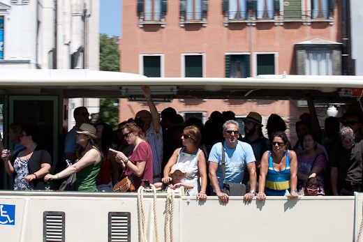 Floating City: Tourists and locals alike cram into a crowded vaporetto on a hot July day.