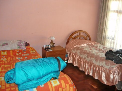 My bedroom. My bed is the frilly one...Erin´s is on the left.