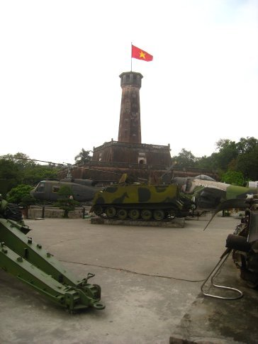 Hanoi flag tower with captured american hardware scattered around it.