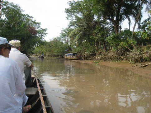 Trip in a rowing boat through the Mekong delta. Looked, but not once did we see a mad Marlon Brando.