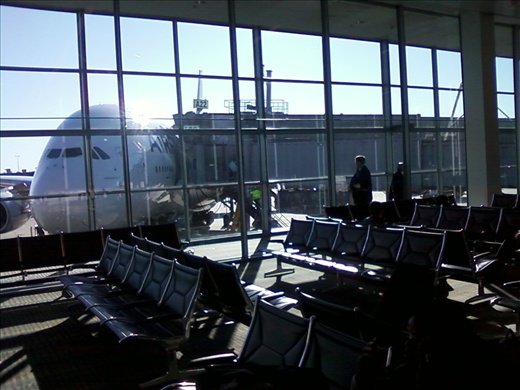At the gate, Dulles Airport, ready to go to Paris to get things rolling