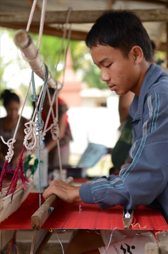 Men are weaving traditional clothes