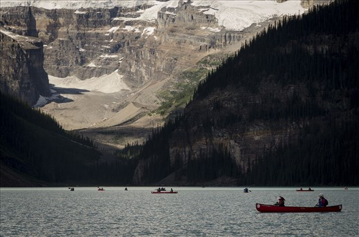 St. Louise Lake, AB filled with ice-cold water, and adventerous Kayakers.