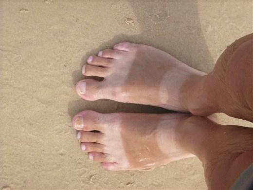 Marks dodgy sun tanned feet