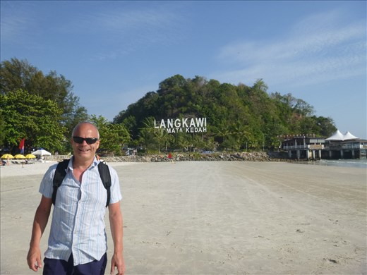 beach on langkawi and food heaven restaurant on right