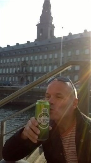 drinking beer the Danish way, sat on the steps at the side of the waterway