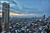 This is when I feel most uneasy with the stark contradictions that reside in me-the obscene high rise buildings and the uncountable slums staring at them, in a curious mix of disbelief and humiliation.  I am Mumbai.  : by debashish, Views[145]