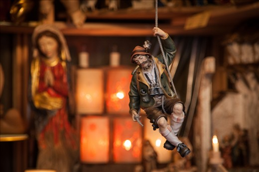 As I ventured further into the town of St. Gilgen, I stumbled upon a small Advent Market. It was mid-day and the streets were quite empty, but the stalls were all open and I had a little browse to see what I could find to put under the Christmas tree back home. This decorative toy, hanging from the ceiling of one of the stands made me feel like I was him - up in the mountains hunting for a bargain. This stand was particularly well decorated, and sold some of the most intricate nativity scenes and religious dolls I've ever seen.