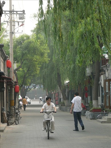 Restored hutong alleys. Men and women in their pijamas, ciclying to work.