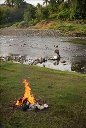Teresa burns off rubbish whilst washing her family's clothing down on the river. Division of labour is obvious in Navala. For the most part, men work on the local farm and ranch whilst women work in the home. Regardless, women's contributions should not be ignored. Womens groups are common throughout many Fijian villages. Navala's womens group gathers often to arrange fundraising and to discuss local events. The night prior to this photo being taken $300 was raised at a meeting for new school carpets and curtains.: by devonhanna, Views[869]