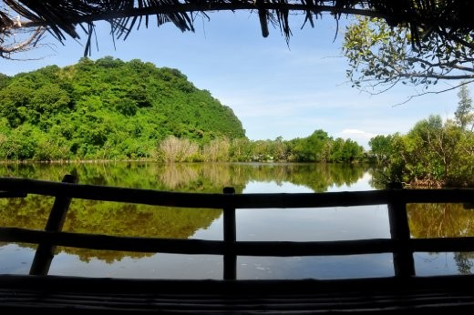 Wake Up To A View. A silhouette of a nipa hut's interiors provides for a pleasing, framed perspective of a lake in Apo Island.