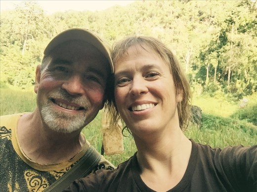 We survived Waterfall Cave!!  Aaron and Dina take a break in the jungle.