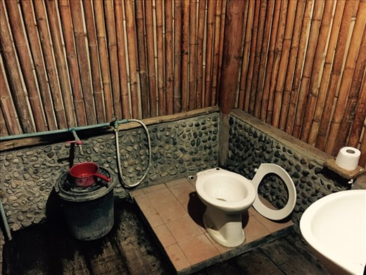 Our hut's bathroom!  Comes with detachable toilet seat!