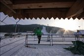 A worker at Nosal Ski Area watches the people while the sun is setting.: by dinowski, Views[241]