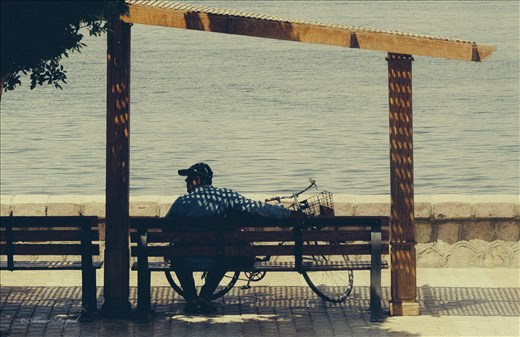 A man with his bike taking rest opposite to him is The Nile .