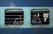 Between 2012 and 2014 I logged more than 300 hours traveling on the Indian Railways, riding in every class and sometimes sleeping near the toilets in the connector joints when I couldn't get a ticket. This is 3am in Chennai. I stepped off the train and spotted these two women looking out of the Ladies Only compartment.: by djoshuajennings, Views[142]