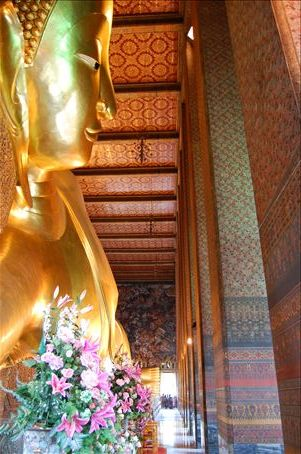 Buddha is very important in Thailand. Those are people at his feet.