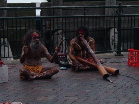 Aboriganees playing their didgerdido