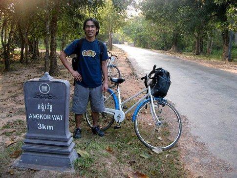 biking to angkor wat, siem reap, cambodia.