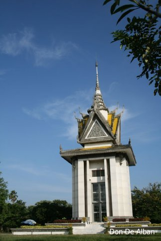 The Choeung-Ek memorial, a buddhist stupa erected in remembrance of the victims of the atrocities of the Khmer Rouge.