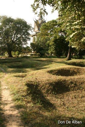Holes dug on the ground where dead bodies were thrown.