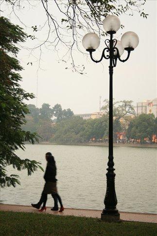Couple walking at Hoan Kiem Lake.