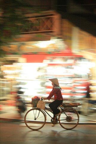 Vietnamese woman on bike.