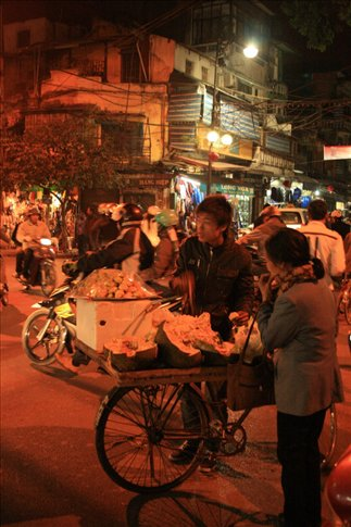A fruit vendor at the Dong Xuan night market.