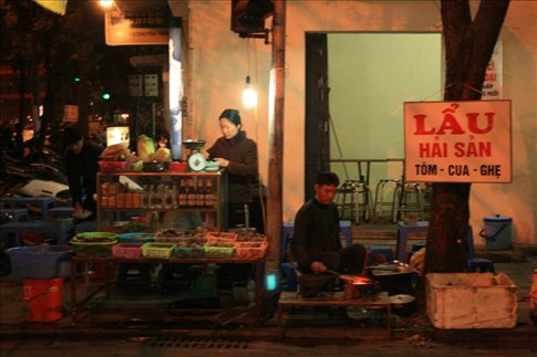 A typical eatery along one of Hanoi's busy streets.