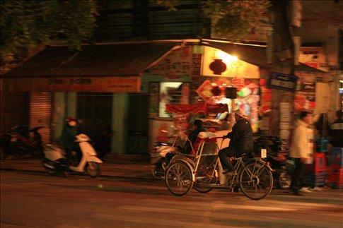Touring around Hanoi on cyclo.