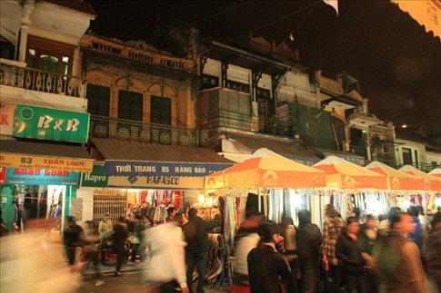At the Dong Xuan night market. Notice the old building architecture.