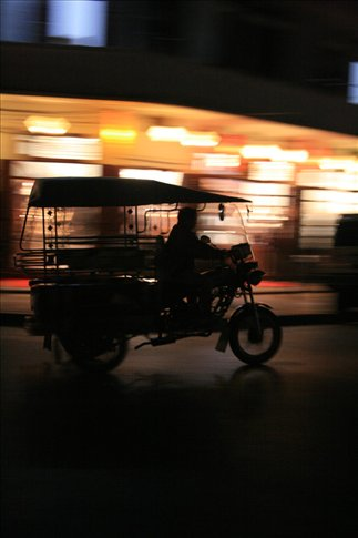I love this photo: a silhouette of a moving tuktuk; I think this was taken along Th Sisavangvong.