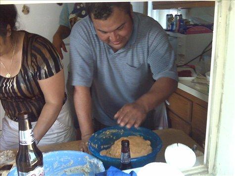 Beto making tamales de puerco