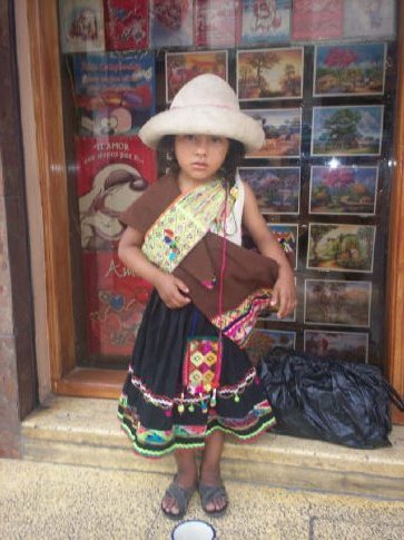 Little Bolivian Girl Who Dances to Music from her Radio for Pesos