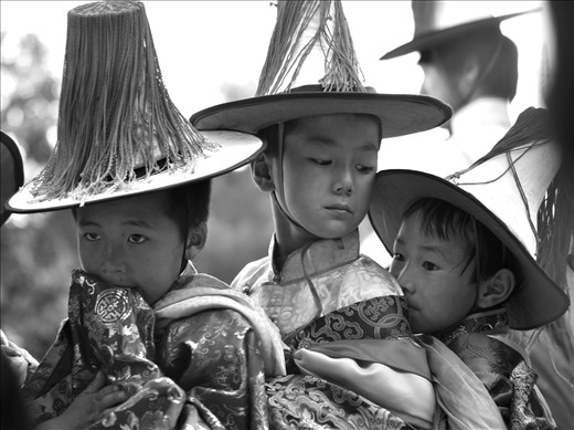 Boys jostle as they parade in line. Many others from the surrounding villages of Rebkong, in Qinghai Province (former Amdo Tibet), take part in this procession as way of penance to appease the surrounding Mountains.