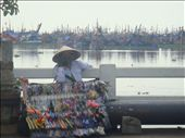 A street vendor wearing a Vietnamese traditional conical hat.: by down_to_earth, Views[203]