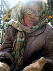 An old women sits on the street at the foot of the people passing...in their eyes she is of cast...an untouchable, a begger, a leper...: by doyouseewhatisee, Views[193]