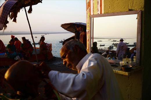 MORNING ACTIVITIES ON THE BANKS OF THE RIVER GANGES AS  ON THE RIVER ITSELF.