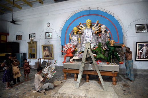"""THE PROCESS OF DECORATION GOING ON. THE IDOL IN THE MIDDLE IS """"GODDESS DURGA""""."""