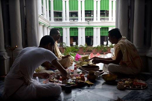 """""""PUJA"""" THE RITUALS OF WORSHIP IS GOING ON IN THE HOUSE OF A FAMILY IN KOLKATA."""