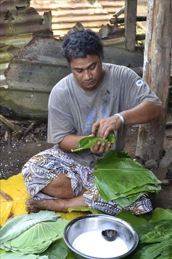 Putting coconut milk into Taro Leaves