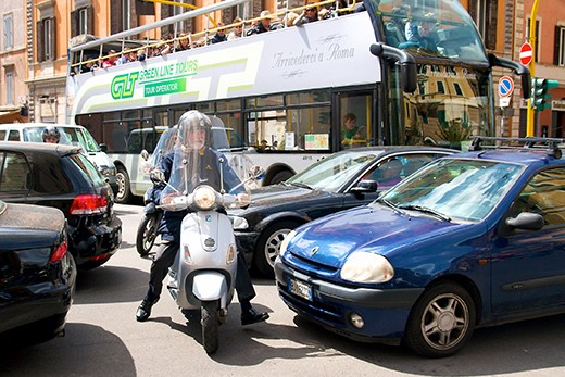 Motorcyclist sneaks through the cars as central Rome comes to a standstill as hoards of people make there way to the Vatican to hear the Pope's Mass on Easter Sunday