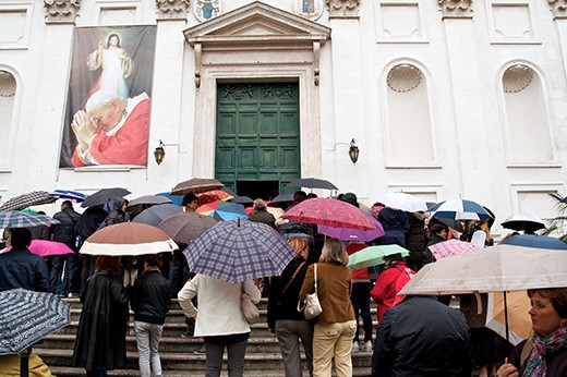 The church's all over Rome struggle to cope with all the parishioners visiting for the various masses over easter. As Pope John Paul is still remembered with a giant billboard.