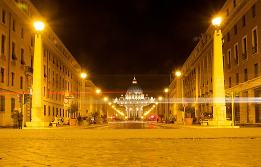 St Peter's Basilica glows in the night time air as Easter Sunday comes to a close in Rome and peace returns to it's streets.