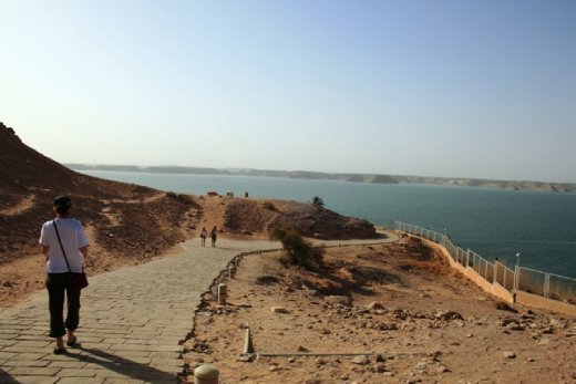 Walking down to the temple of Abu Simbel - blue water is Aswan Dam